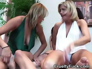 Fully Clothed Women Sucking One Cock Together At Party