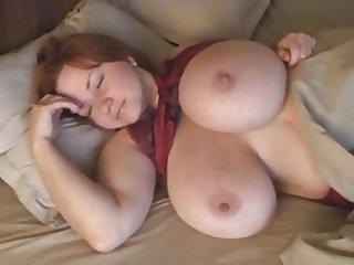 Massive breasts of a beautiful redhead.