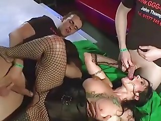 Tattooed pole dancer go hardcore in a bukkake orgy