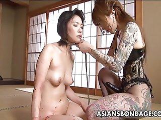 Tattooed up Asian domina strap on fucking the sub