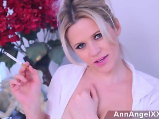 Ann angel smoking seductively in pink