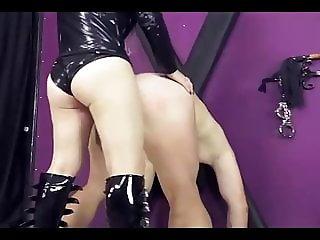 Blond Mistress pegging her slave
