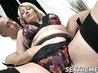 Busty mature babe with pussy piercings fucks younger stud