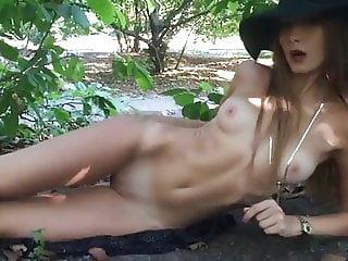 Beautiful girl loves fingering in public woods