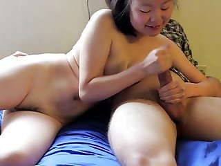 Korean Cum Whore, Justine Lim, Stroking a white Cock