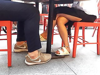 Long crossed legs, sexy feets under table