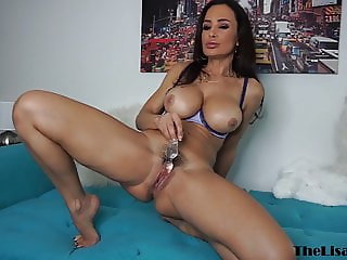 Busty MILF Lisa Ann uses dildo for her trimmed tight pussy